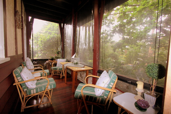 Guests may relax on the Veranda or have breakfast on a hot day