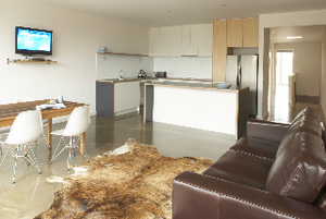 Full size kitchen and spacious interior throughout - Apartment 2