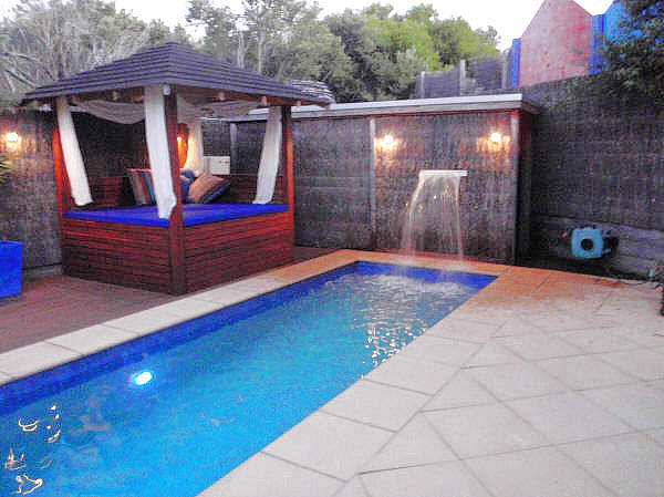 Pool showing Bali Day Bed and waterfall feature