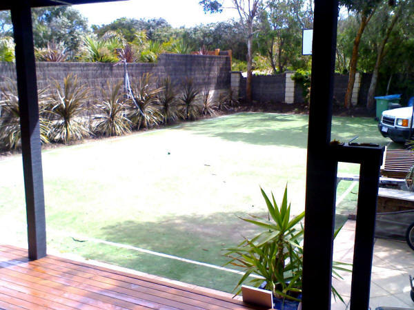 Half-size tennis/volleyball court and basketball ring