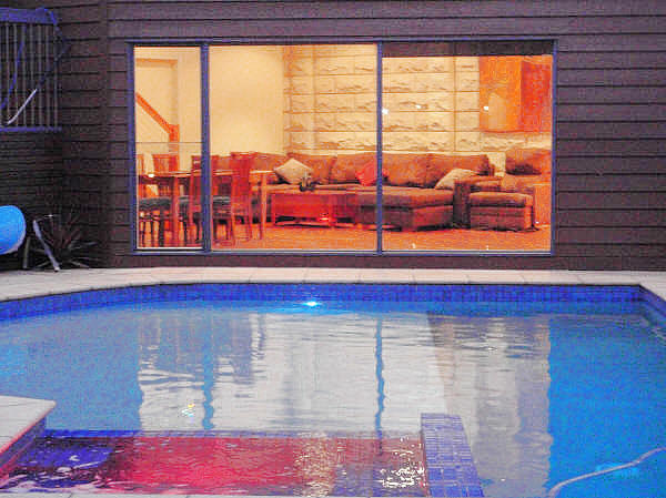 In ground solar heated 15m pool with gas-heated spa
