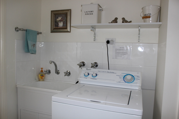 Separate laundry with large washing machine