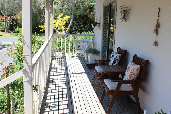 Relax on the verandah, also table & chairs for outdoor dining