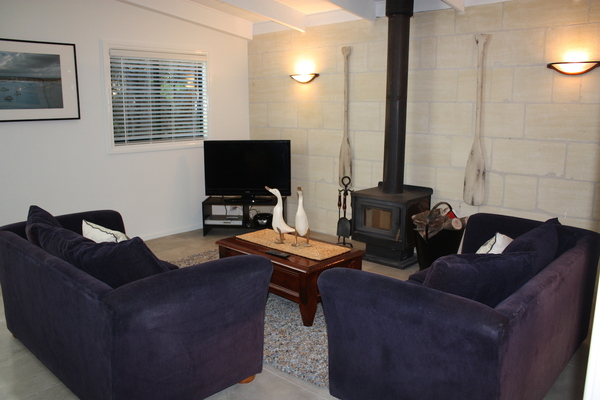 Spacious lounge, flatscreen TV, air con and wood fire